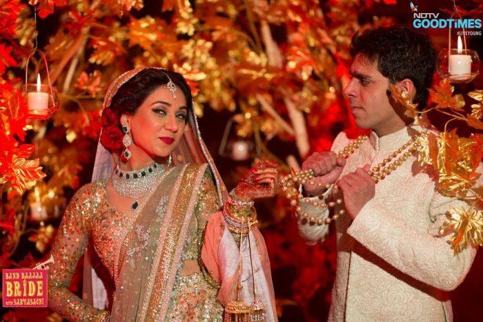 sabyasachi-gold-lehenga-band-baaja=bride