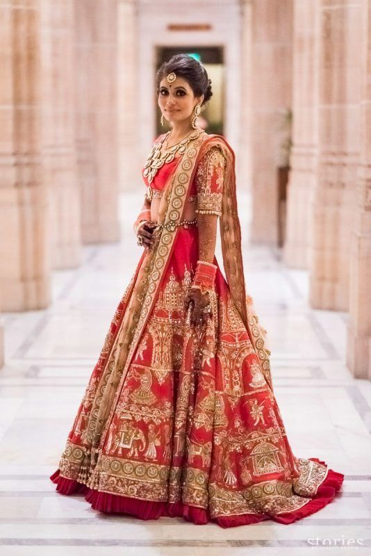 94bd680eaa This bride's customised red lehenga with the baraat procession design