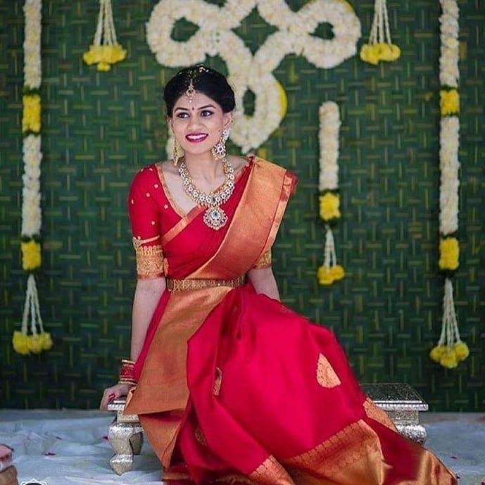 Bridal red kanjivarams saree with jewel tones