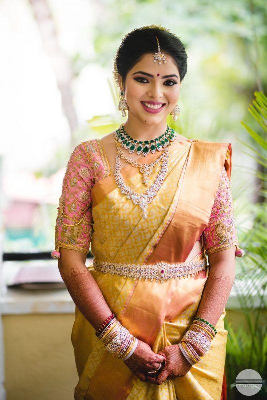 Gold kanjeevaram saree with light pink blouse