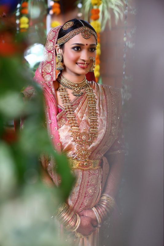 Pink bridal kanjeevaram with heavily embroidered veil