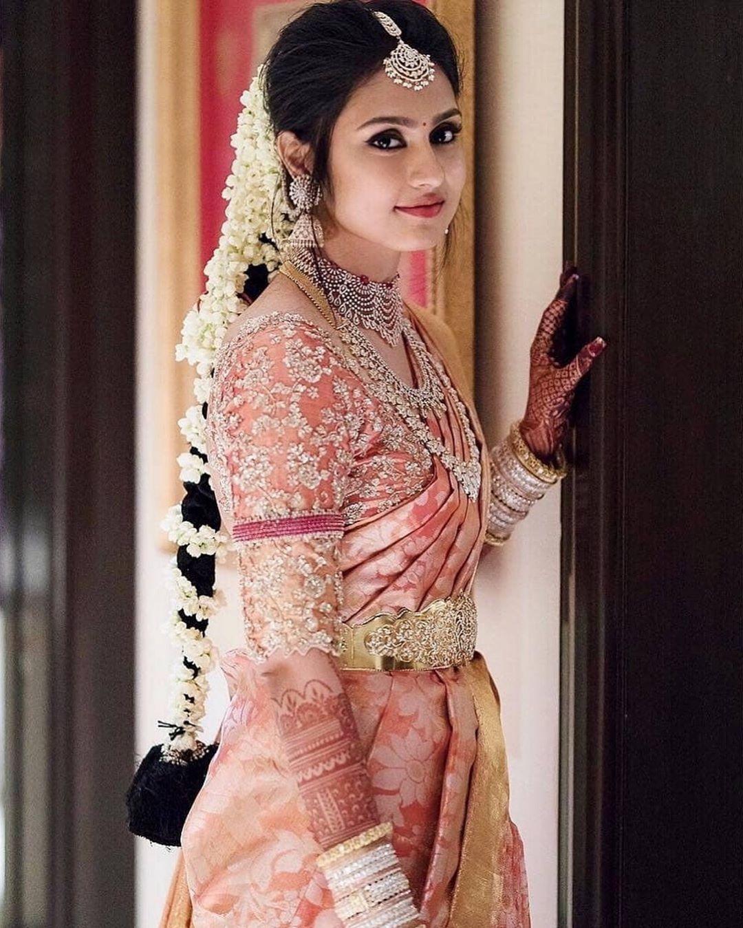 Light pink bridal kanjeevaram saree with embroidered blouse
