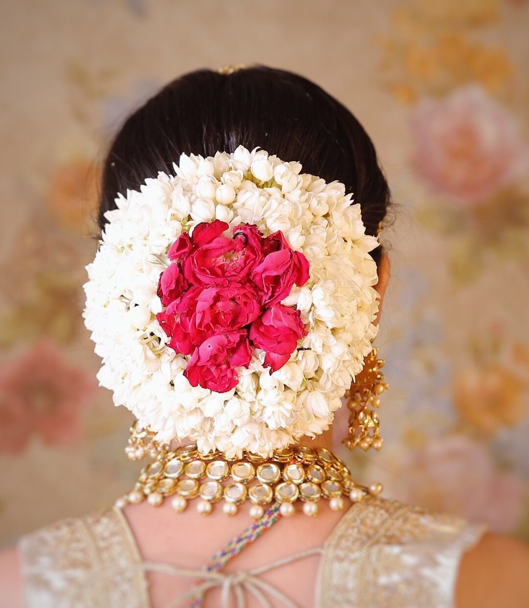 Bridal Bun Hairstyle with Gajra and roses