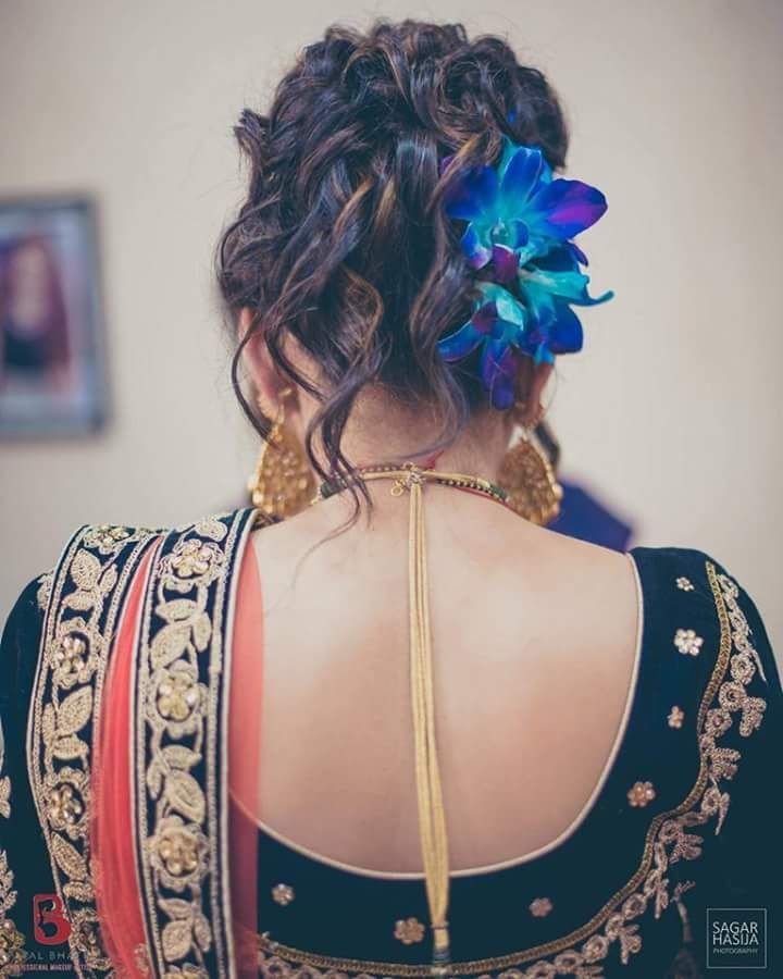 Bun hairstyle with lilies