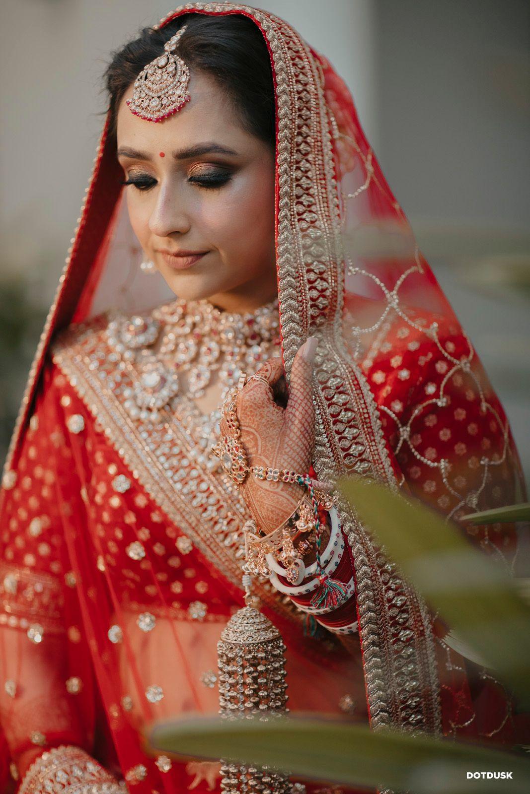 bride in a red lehenga