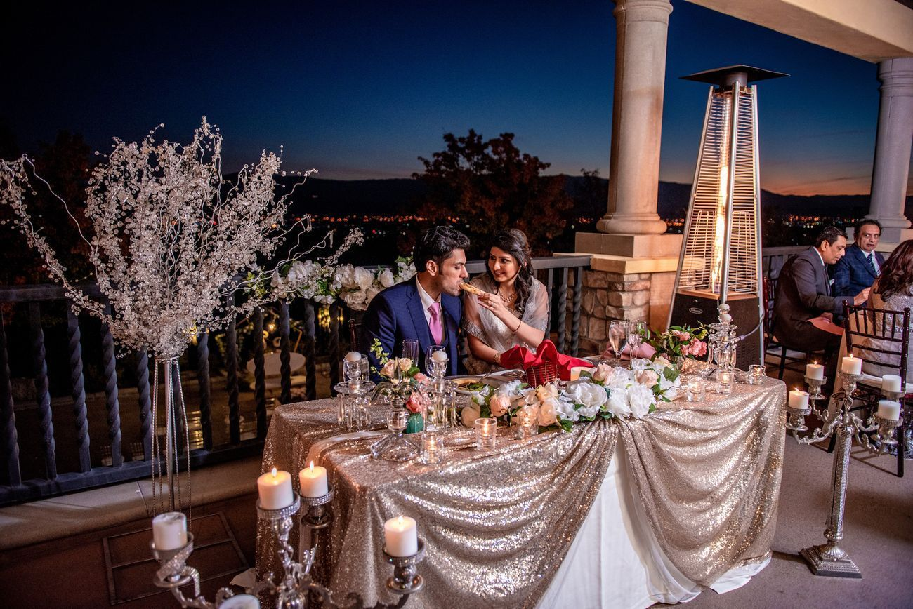 couple sitting with pretty engagement table setting