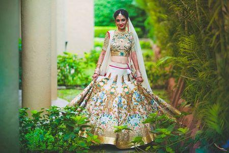 Pretty Pune Wedding With A Unique Ivory Lehenga
