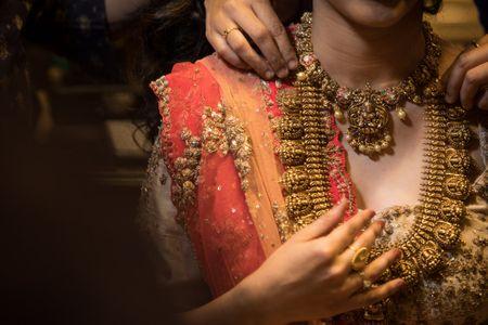 Red Carpet Bride at Manubhai Jewellers: The Temple Jewellery Bride!