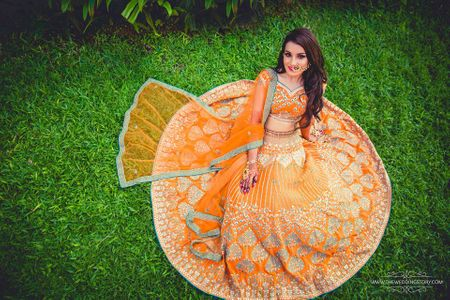 A Pretty Mehendi in Goa With A Vibrant Orange Lehenga!