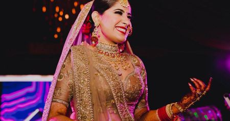 A Glam Delhi Wedding With A Bride In A Spectacular Bronze Gold Lehenga