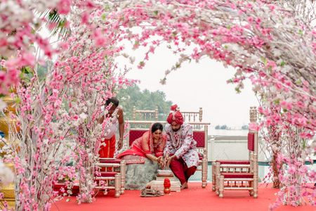 An Elegant Goa Wedding With Cherry Blossoms And The Bride In A Silver Grey & Red Lehenga