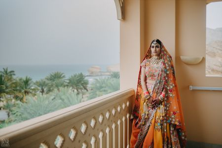A Gorgeous Destination Wedding With The Bride In An Orange Lehenga!