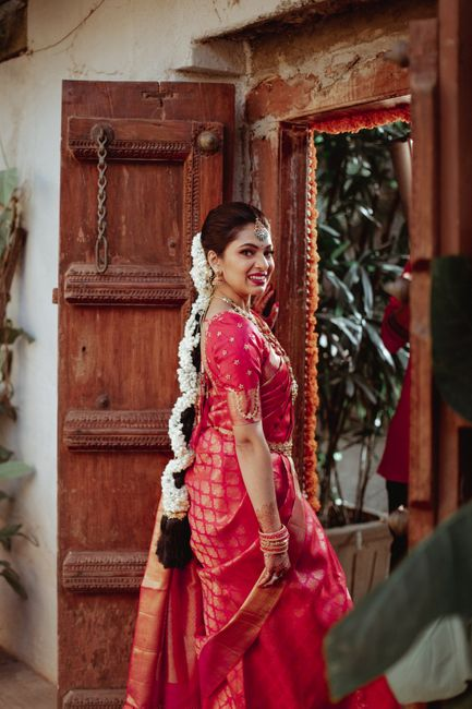 A Traditional Bangalore Wedding With The Bride In A Bright Pink Kanjeevaram
