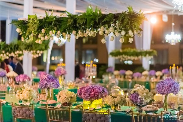 Indoor Reception Decor With Gorgeous Florals And Hanging Trellis