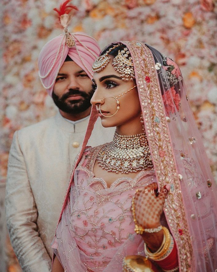 This bride's pretty nude lip with her light pink lehenga!