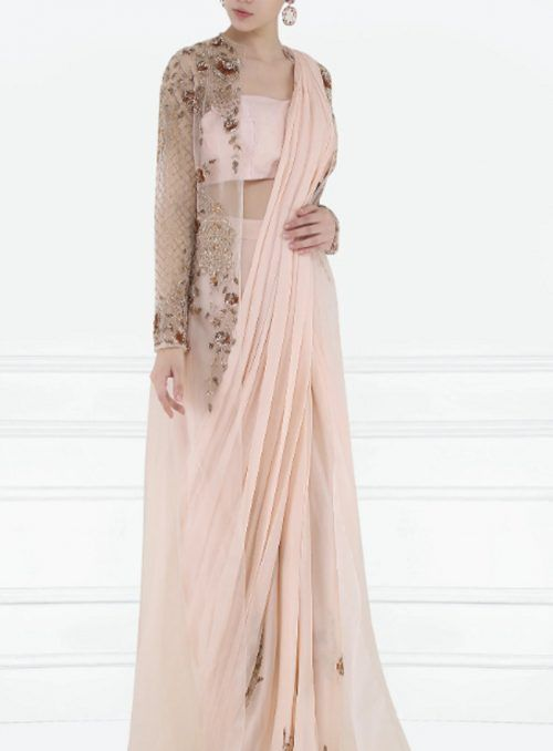 5478c8494f947e Pre-stitched sarees make it so easy to carry off the saree! This peach  beauty with rose gold 3D hand embroidery is simply lovely!