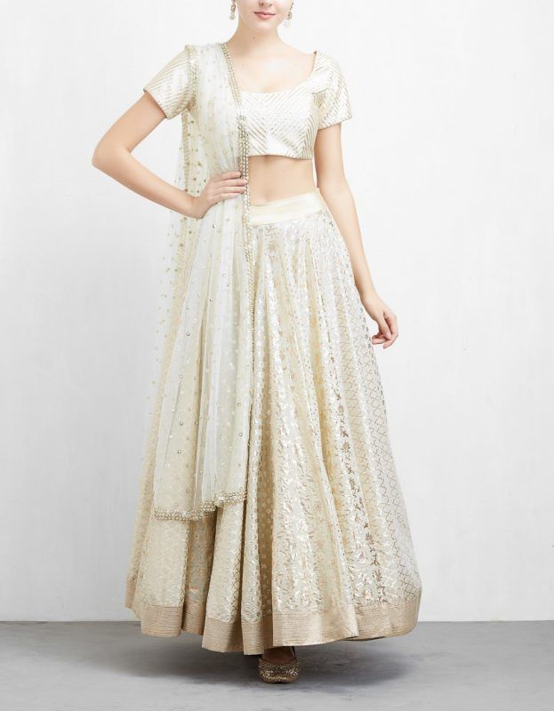 9512c78170bb8 Ivory is trending like no other this year. Both these lehengas are gorgeous  to say the least. You can opt for the tangerine dupatta one if you like a  little ...