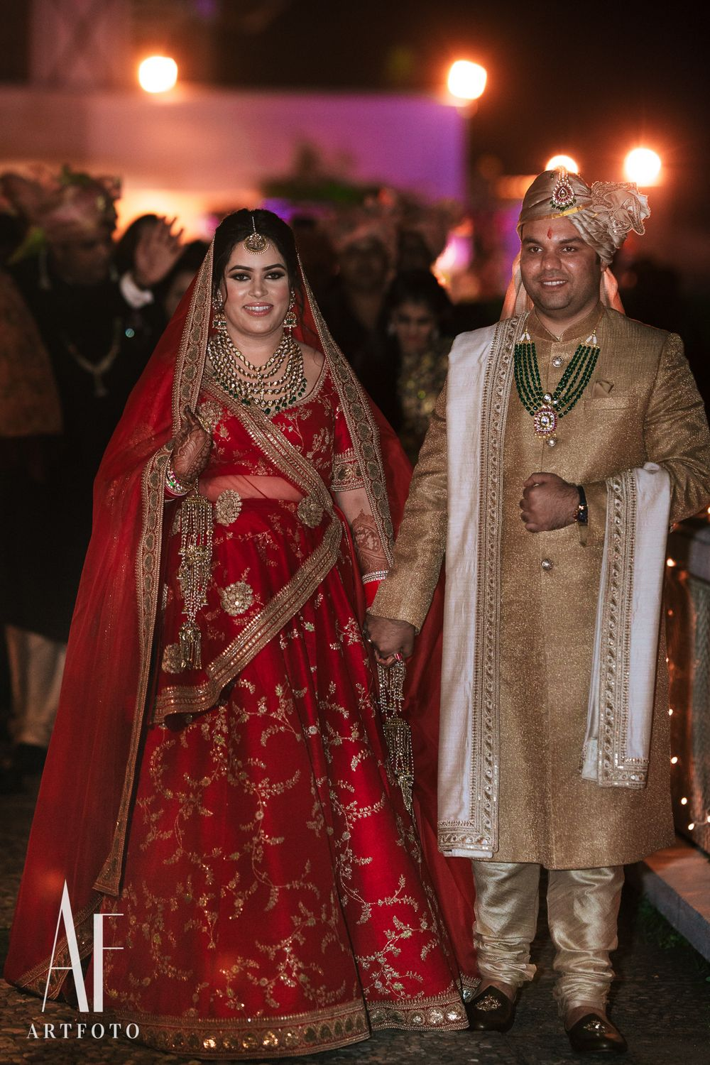 Photo of Contrasting bride and groom in sabyasachi outfits