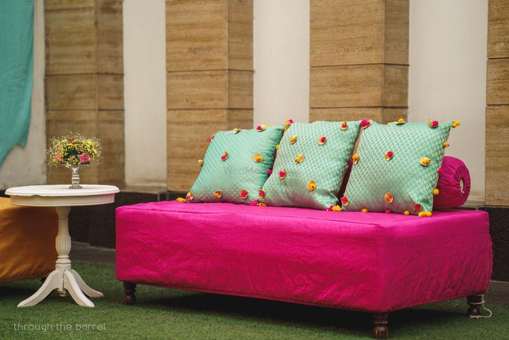 Photo of DIY mehendi decor pompom cushions