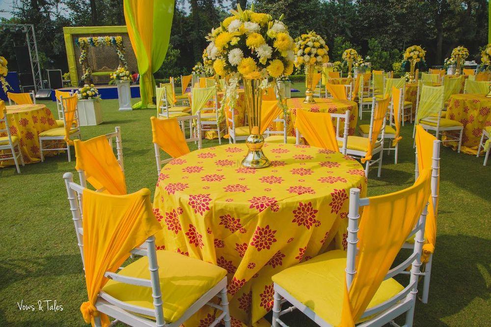 Photo of Mehendi decor ideas with yellow table setting