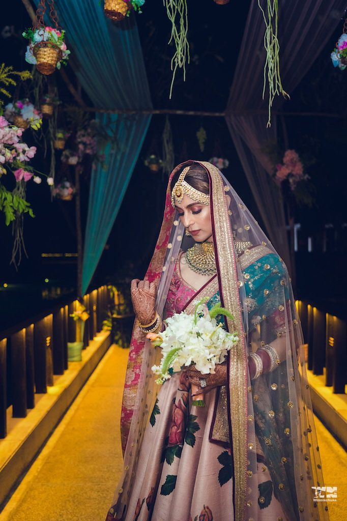 Photo of Sabyasachi floral print bridal lehenga