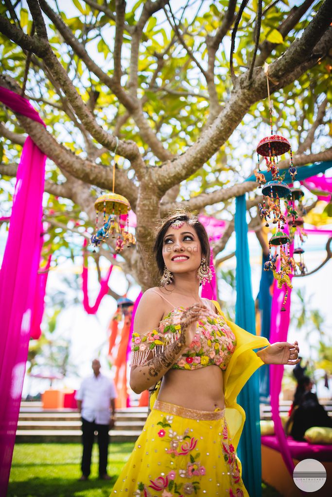 Photo of Unique props and a bride to be in yellow lehenga for her mehendi
