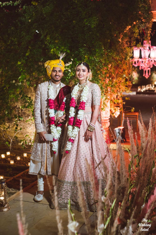 Photo of post wedding couple portrait with unique jaimalas