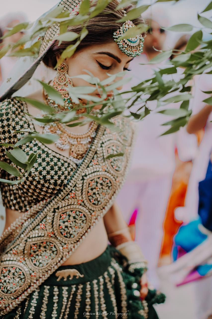 Photo of Offbeat bridal lehenga with bride wearing belt