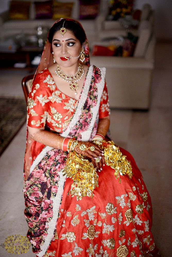 Photo of Red and gold bridal lehenga with floral print dupatta