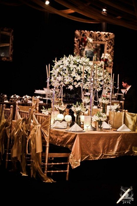 Photo of glamorous table settings with back decor