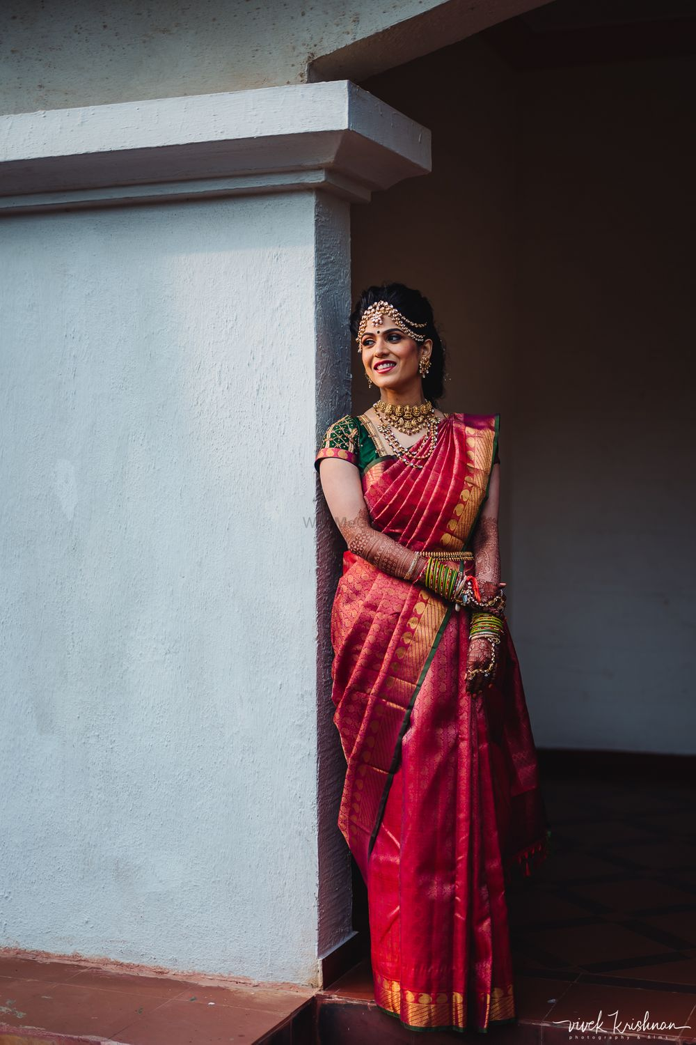 Photo of South indian bridal look in red and green kanjivaram