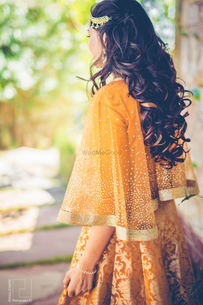 Photo of Mustard mehendi lehenga with cape