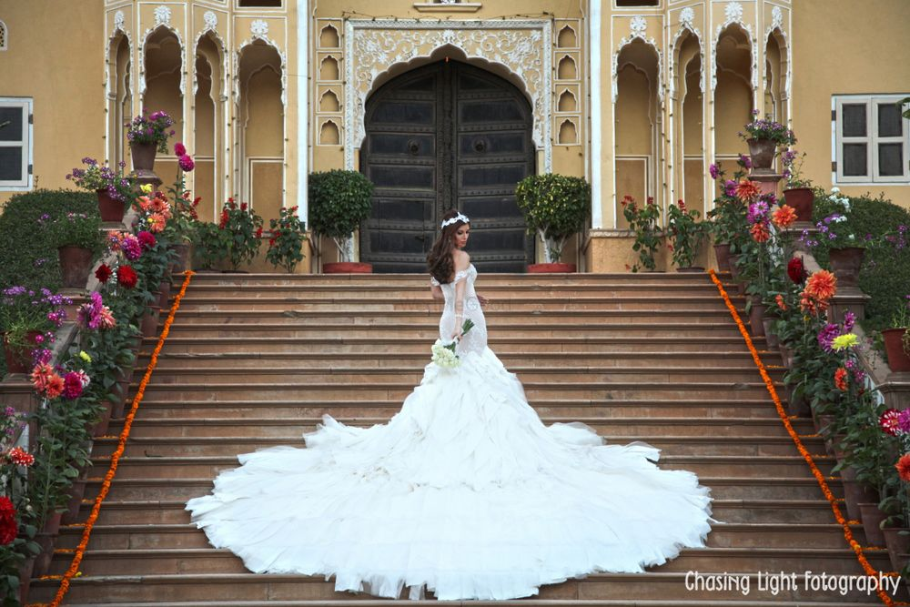 Photo of Ruffled White Wedding Gown with Dramatic Train