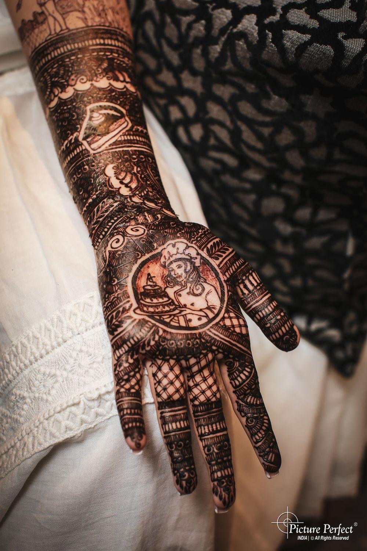 Photo of personalised mehendi design on bridal hands