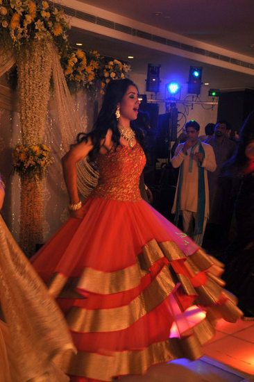 Photo of red anarkali with lots of flare