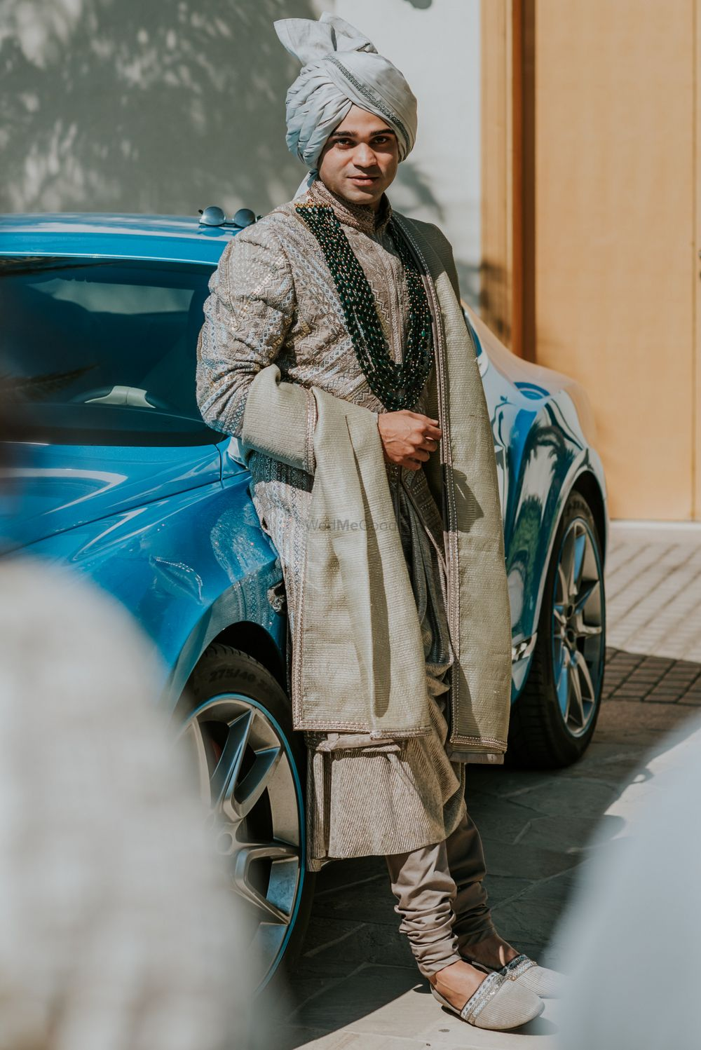 Photo of groom sherwani with in sage green with darker necklace