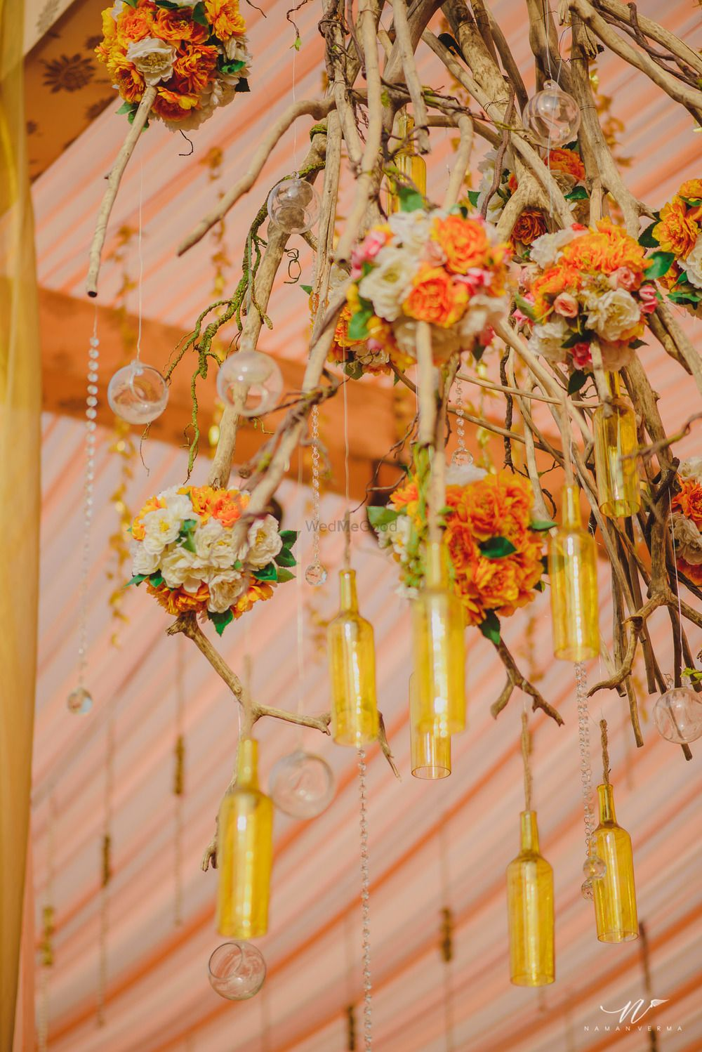 Photo of Bottles and floral suspended