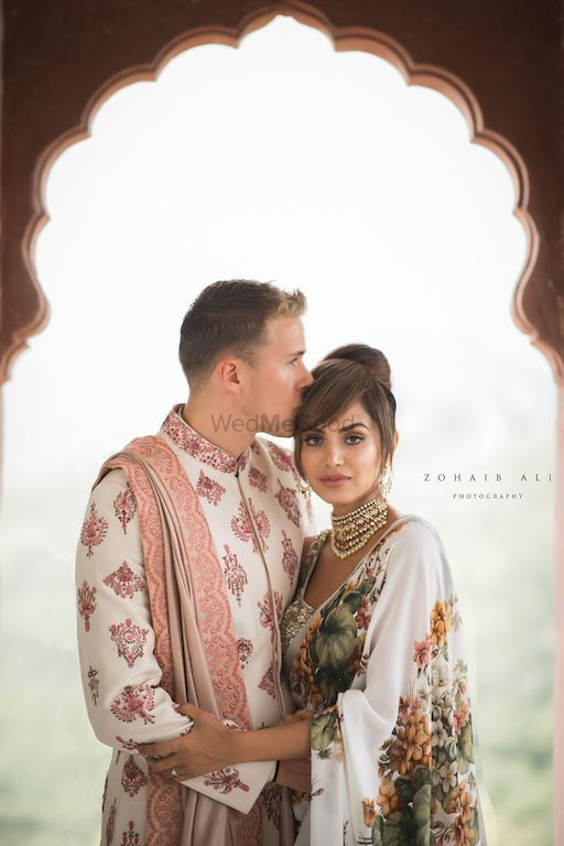 Photo of Mehendi couple portrait bride in saree