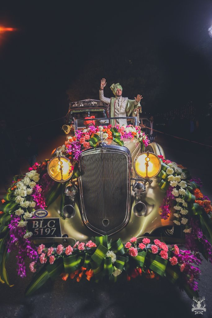 Photo of Groom entering in decked up vintage car