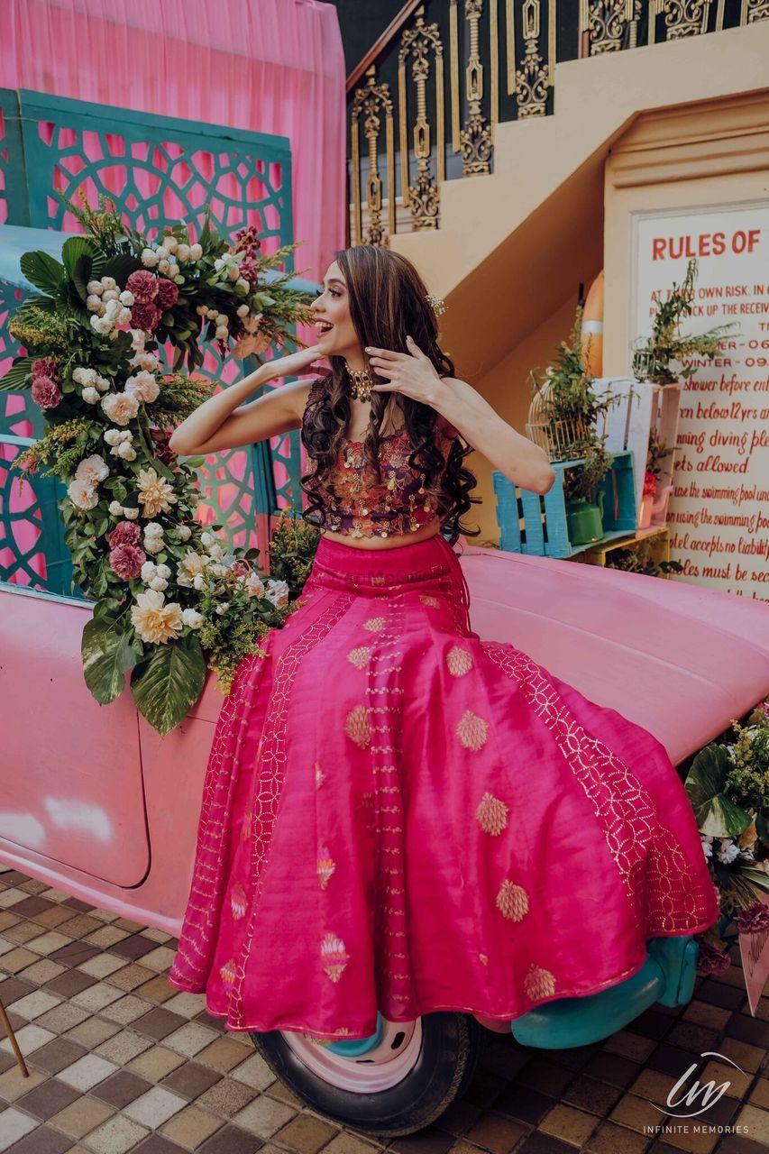 Photo of bride in simple bright pink lehenga for mehendi