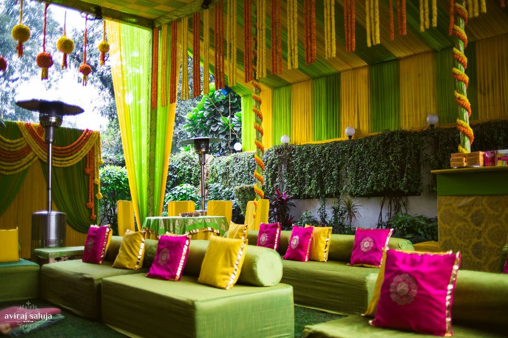 Photo of Colorful Mehendi decor in pink and yellow