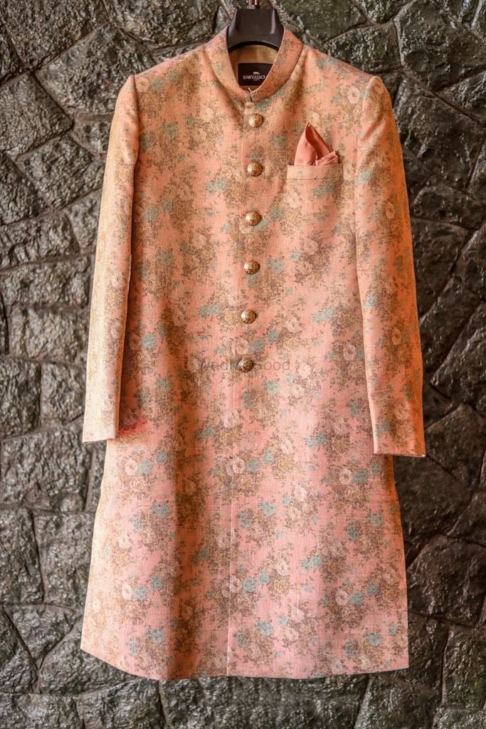 Photo of Peach sabyasachi sherwani on hanger