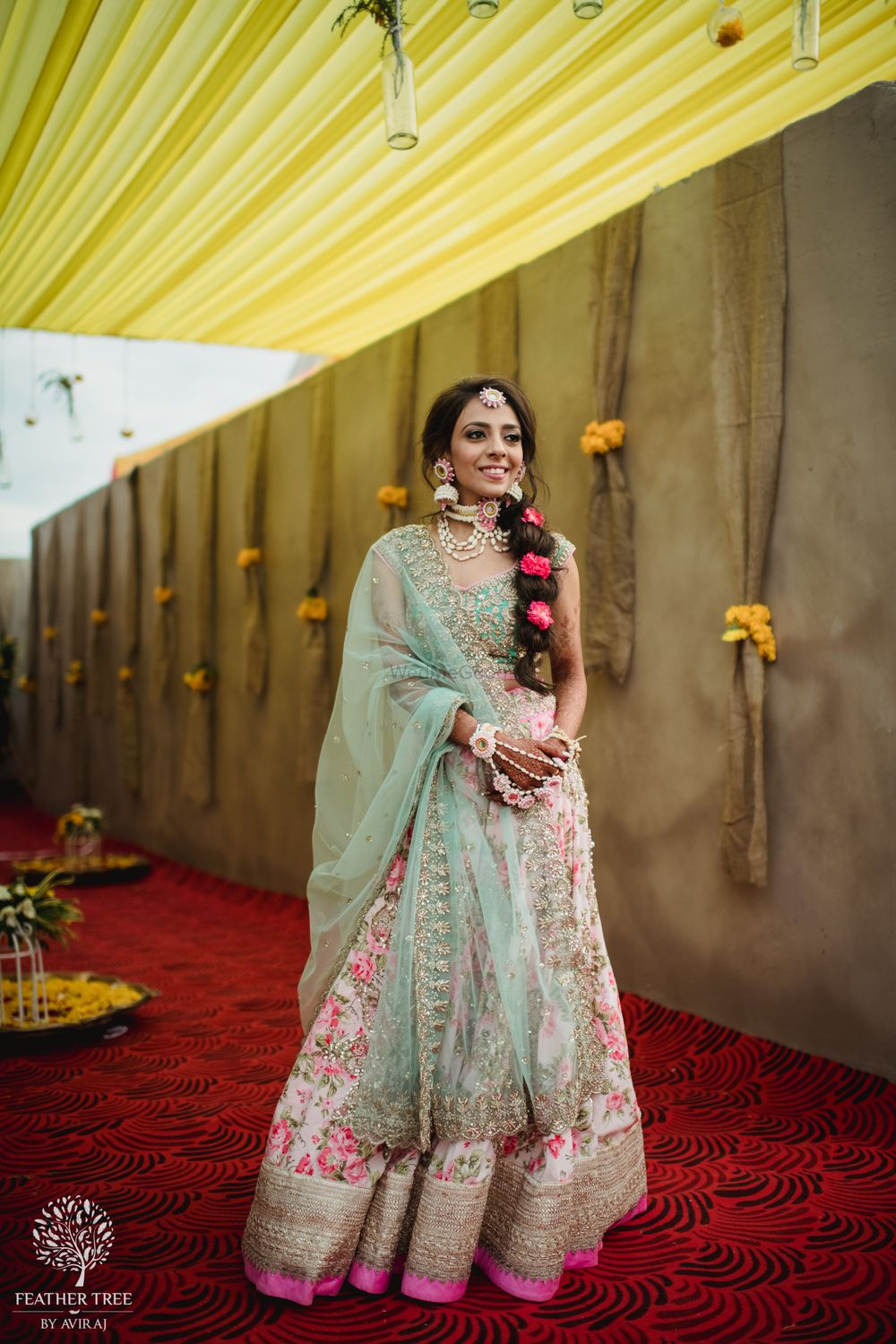 Photo of Mehendi bridal look with mint and pink lehenga