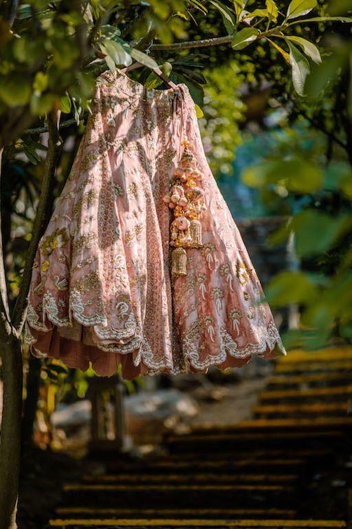 Photo of Offbeat dusty peach lehenga on hanger