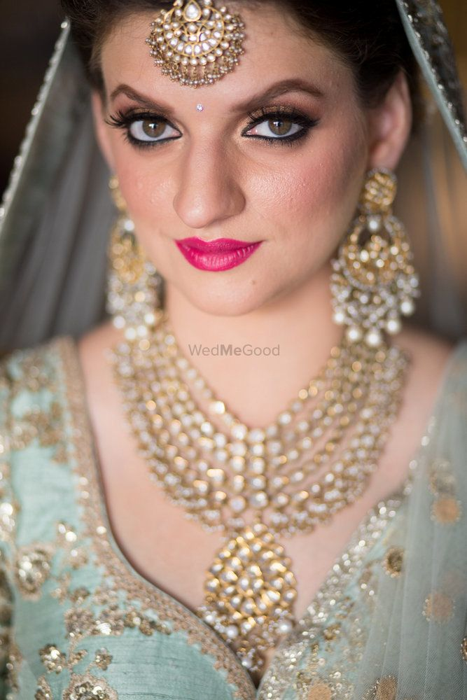 Photo of Bright pink lipstick with pastel lehenga
