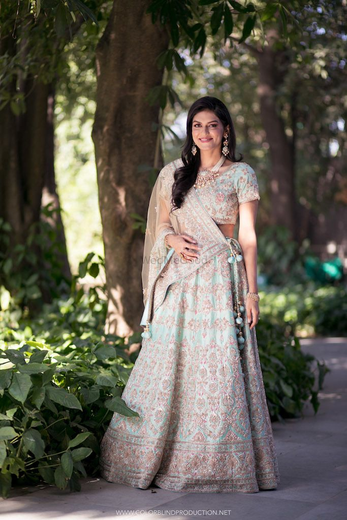 Photo of A bride poses in powder blue lehenga