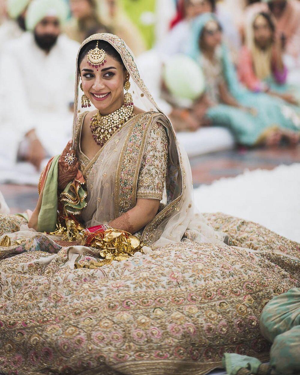 Photo of Ivory and gold bridal lehenga by Sabyasachi