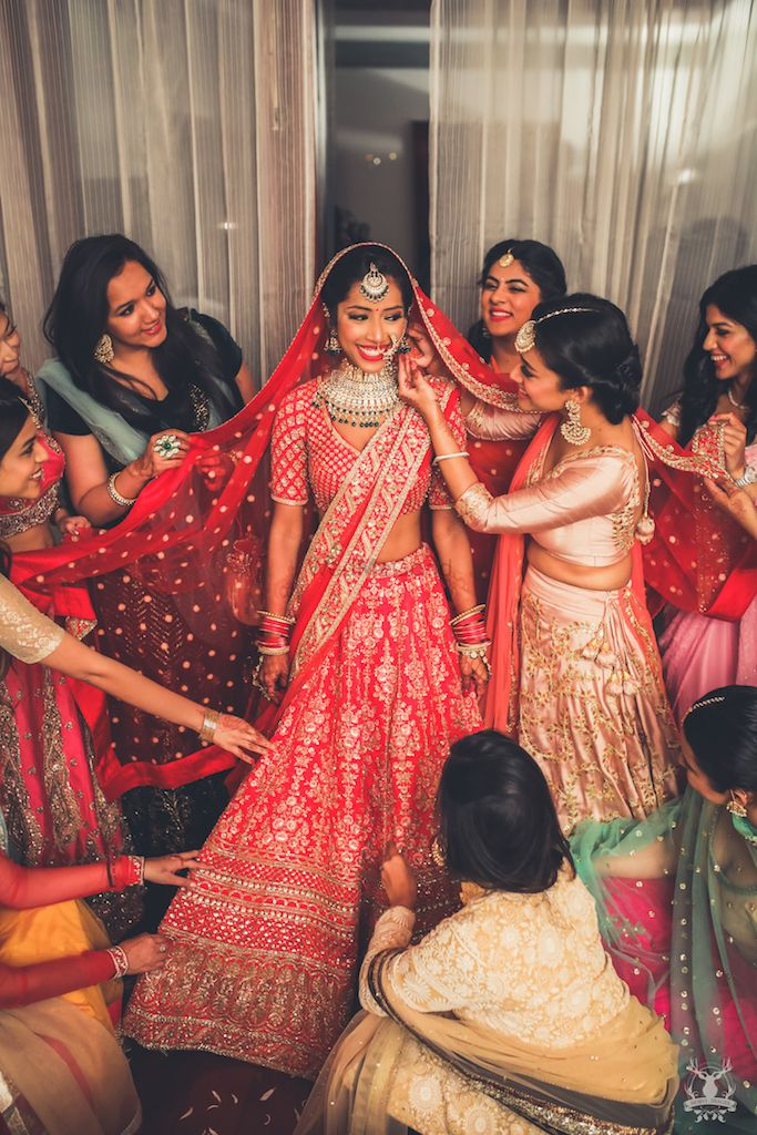 Photo of Bridal getting ready shot with bridesmaids pulling cheeks