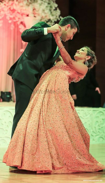 Photo of Peach floor length sleeveless voluminous full flare sparkly gown with sequin work