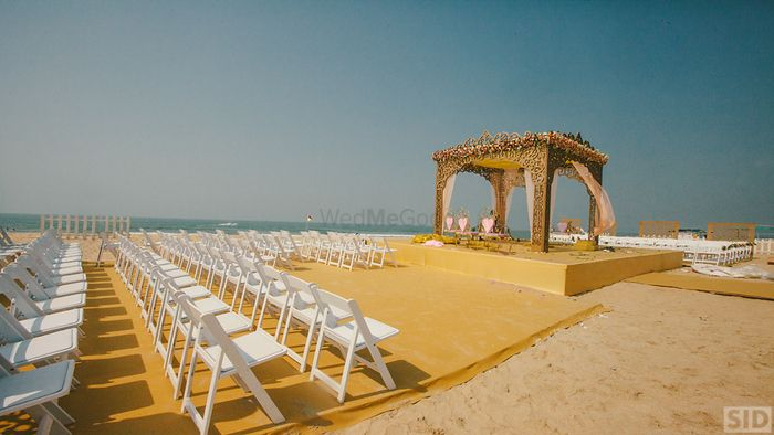 Photo of Beach wedding gold and white mandap with rose gold structure